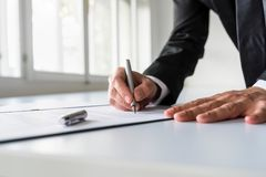 Businessman in office signing contract Royalty Free Stock Photos