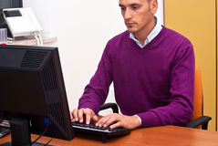 Businessman in office. Businessman sitting and using keyboard  in office Royalty Free Stock Photo