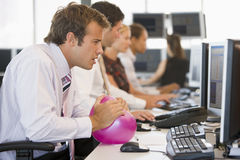 Businessman in office space with a ball Royalty Free Stock Image