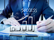 Businessman in a Office and Success Chart.  Royalty Free Stock Images
