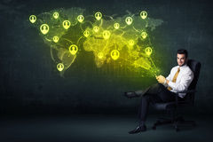 Businessman in office with tablet and social network world map Stock Image