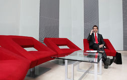 Businessman in office talking on cellphone Stock Photo