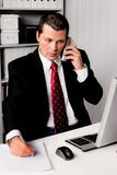 Businessman in office with telephone royalty free stock images