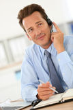 Businessman at office using headset Royalty Free Stock Photography