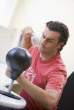 Businessman in office using small punching bag Royalty Free Stock Photo