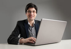 Businessman in office working on his laptop Royalty Free Stock Image