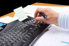 Businessman at office working at his workplace Royalty Free Stock Image