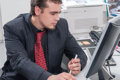 Businessman in office working with PC Royalty Free Stock Photo