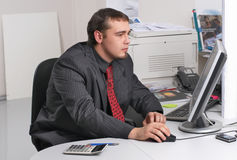Businessman in office working with PC Stock Image