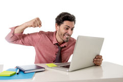 Businessman at office working stressed on computer laptop overworked throwing punch in work stress Royalty Free Stock Images