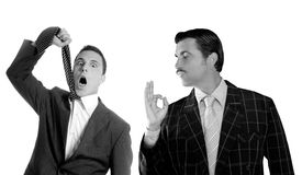 Businessman ok gesture hangman depressed by crisis. Mustache retro businessmen with ok gesture hand and tie hangmen depressed both side of a crisis Stock Images