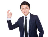 Businessman with ok gesture Stock Images
