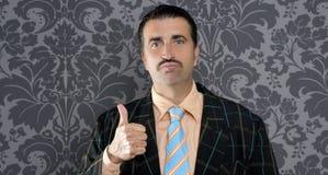 Businessman ok positive hand gesture. Nerd businessman gesturing ok positive with hand over retro wallpaper Stock Photos
