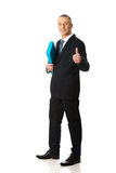 Businessman with ok sign holding a binder. Mature businessman with ok sign holding a binder Stock Photos