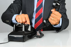 Businessman With Old Fashioned Phone Royalty Free Stock Photo