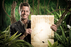 Businessman with old paper parchment in the jungle Royalty Free Stock Photos