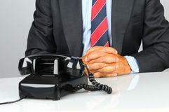 Businessman and old phone Stock Photo
