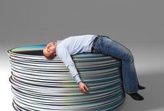 Free Businessman On Cd Pile Stock Image - 17375411