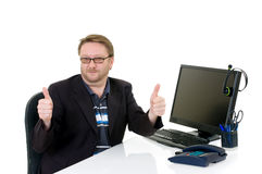 Businessman On Desk Royalty Free Stock Photos