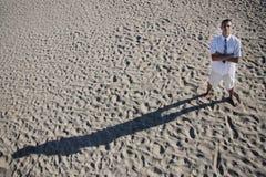 Businessman On Sand Background Stock Photo