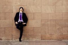 Businessman On Wall Stock Photo