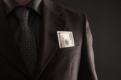 Businessman with one hundred dollars Stock Photos