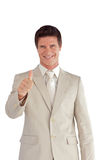 Businessman with one thumb up Royalty Free Stock Image