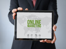 Businessman with online marketing  on a tablet Royalty Free Stock Photo