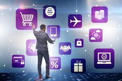 The businessman in online trading and shopping concept stock image