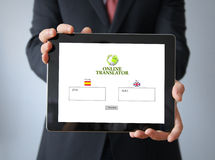 Businessman with online translator on a tablet Royalty Free Stock Photo