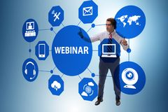 The businessman in online webinar concept stock image
