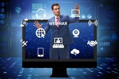 The businessman in online webinar concept stock image