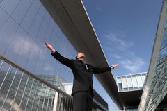 Businessman with open arms to the sky success concept Stock Photography
