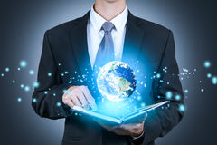 Businessman open a book to see a world.concept,education .elements of this image furnished by NASA Stock Photo