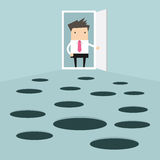 Businessman open the door and looks at hole on the ground Royalty Free Stock Images