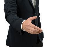 Businessman open hand for handshake to make a deal with partner isolated on white background. With clipping path Stock Images