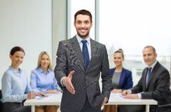 Businessman with open hand ready for handshake Stock Images