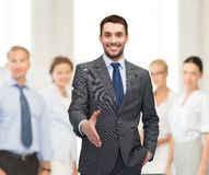 Businessman with open hand ready for handshake Royalty Free Stock Images