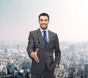 Businessman with open hand ready for handshake Stock Photo