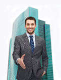 Businessman with open hand ready for handshake Royalty Free Stock Image