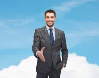Businessman with open hand ready for handshake Stock Photography