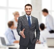 Businessman with open hand ready for handshake Royalty Free Stock Photography