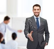 Businessman with open hand ready for handshake Stock Photos