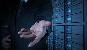 Businessman open hand and server room Stock Images