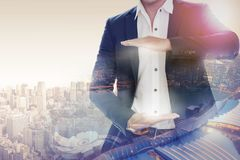 Businessman open hand for your text. Businessman opening palms making hand gestures to build copy space for your business text or logo with modern city in stock images