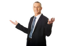 Businessman with open hands in undecided gesture Royalty Free Stock Images