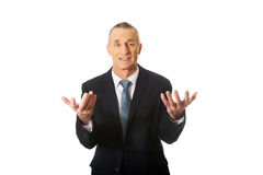 Businessman with open hands in undecided gesture Royalty Free Stock Photography