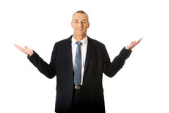 Businessman with open hands in undecided gesture Stock Photography