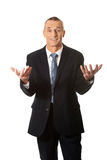 Businessman with open hands in undecided gesture Royalty Free Stock Photos