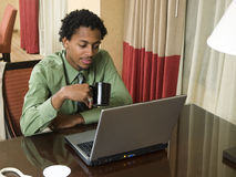 Businessman with open laptop Stock Image